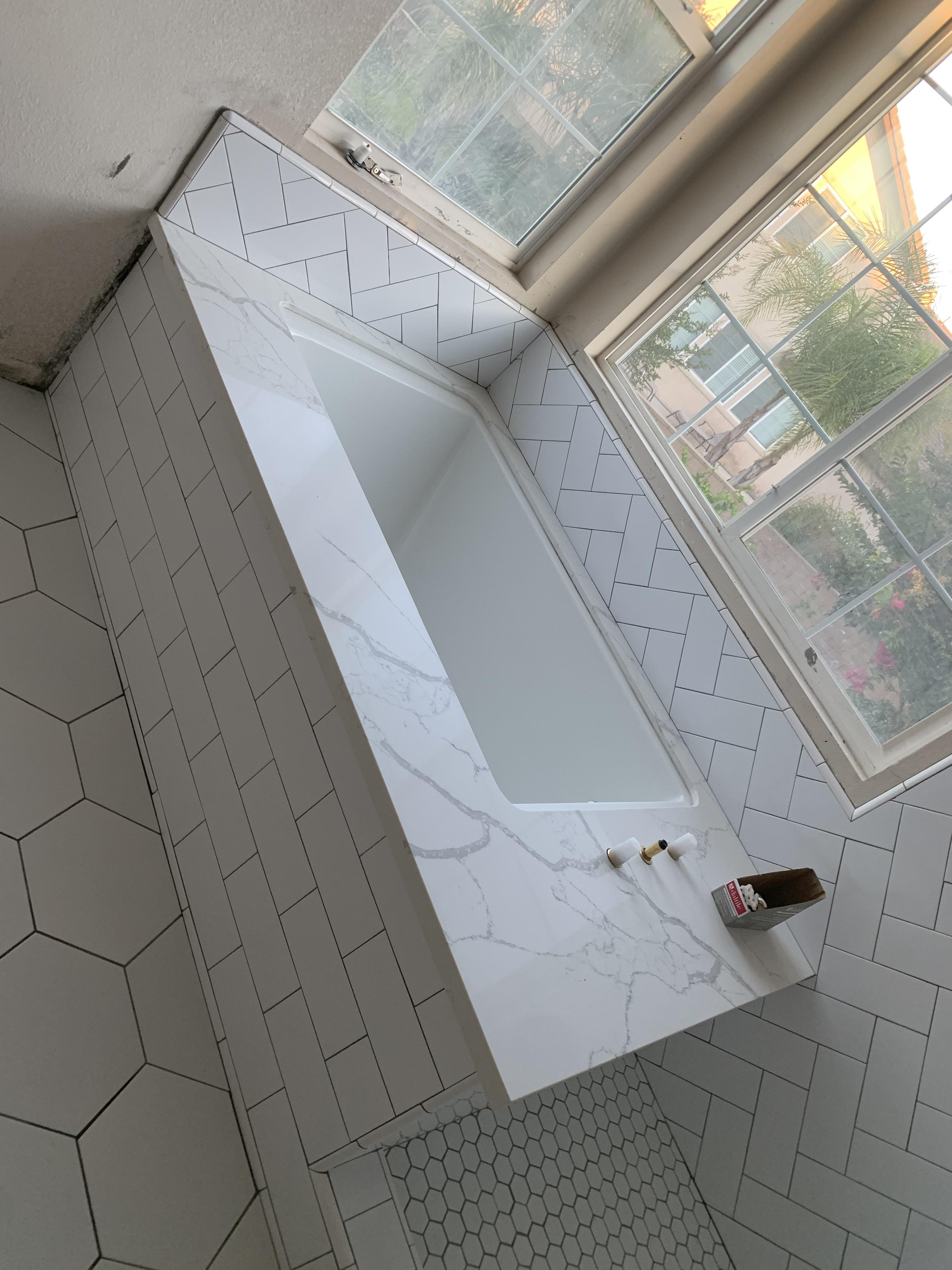 white tile and black grout shows