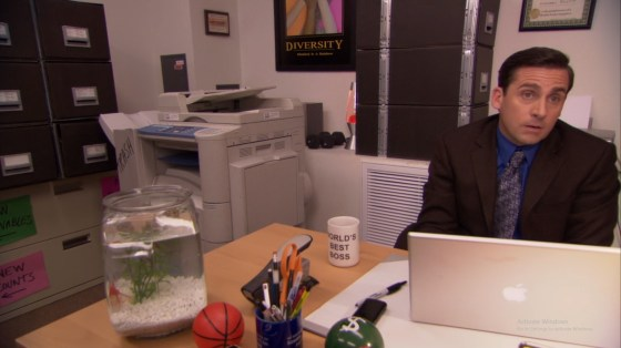 Michael sat at his desk with a fish bowl on it