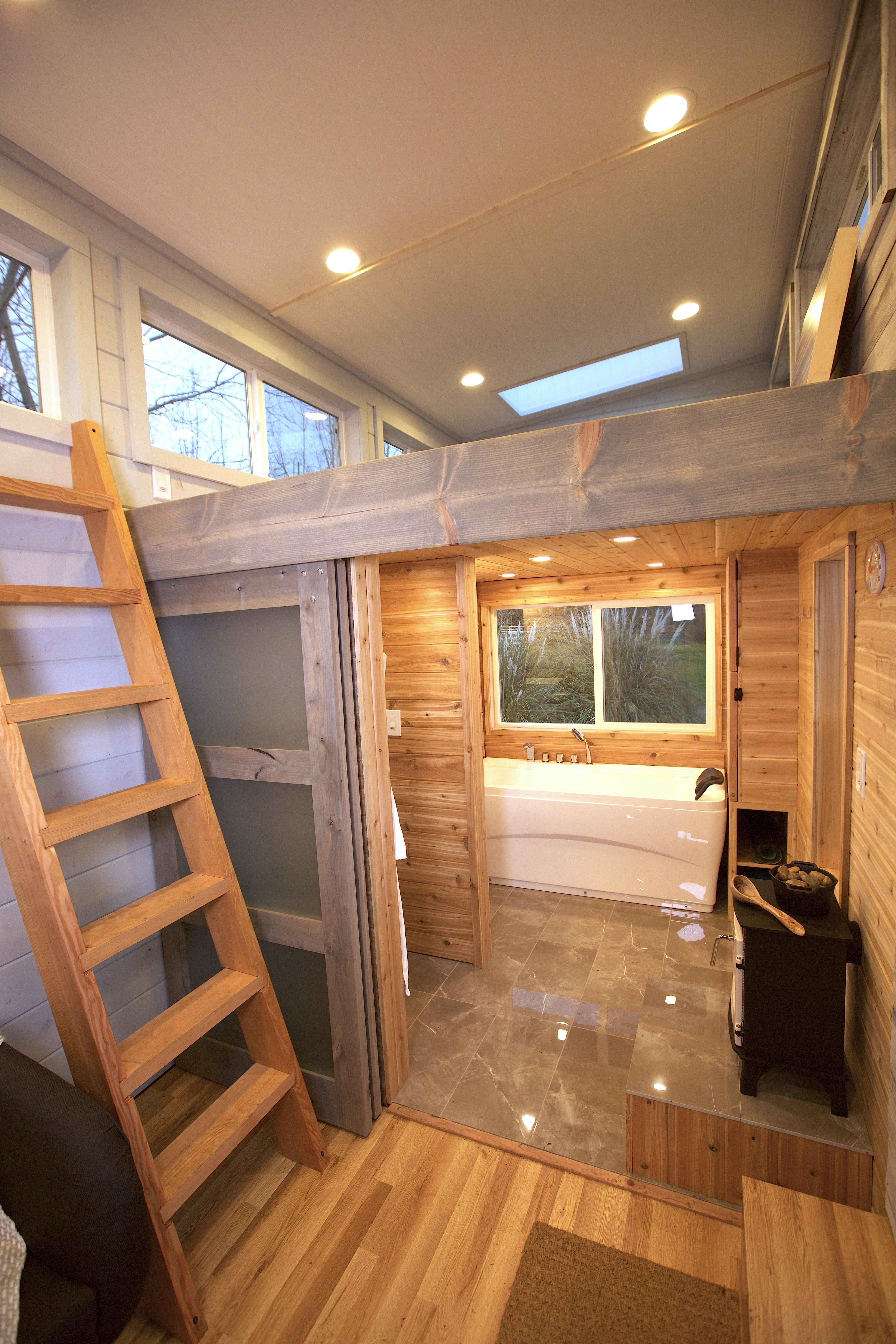 tiny house bathroom that converts into a sauna. nesting doors open