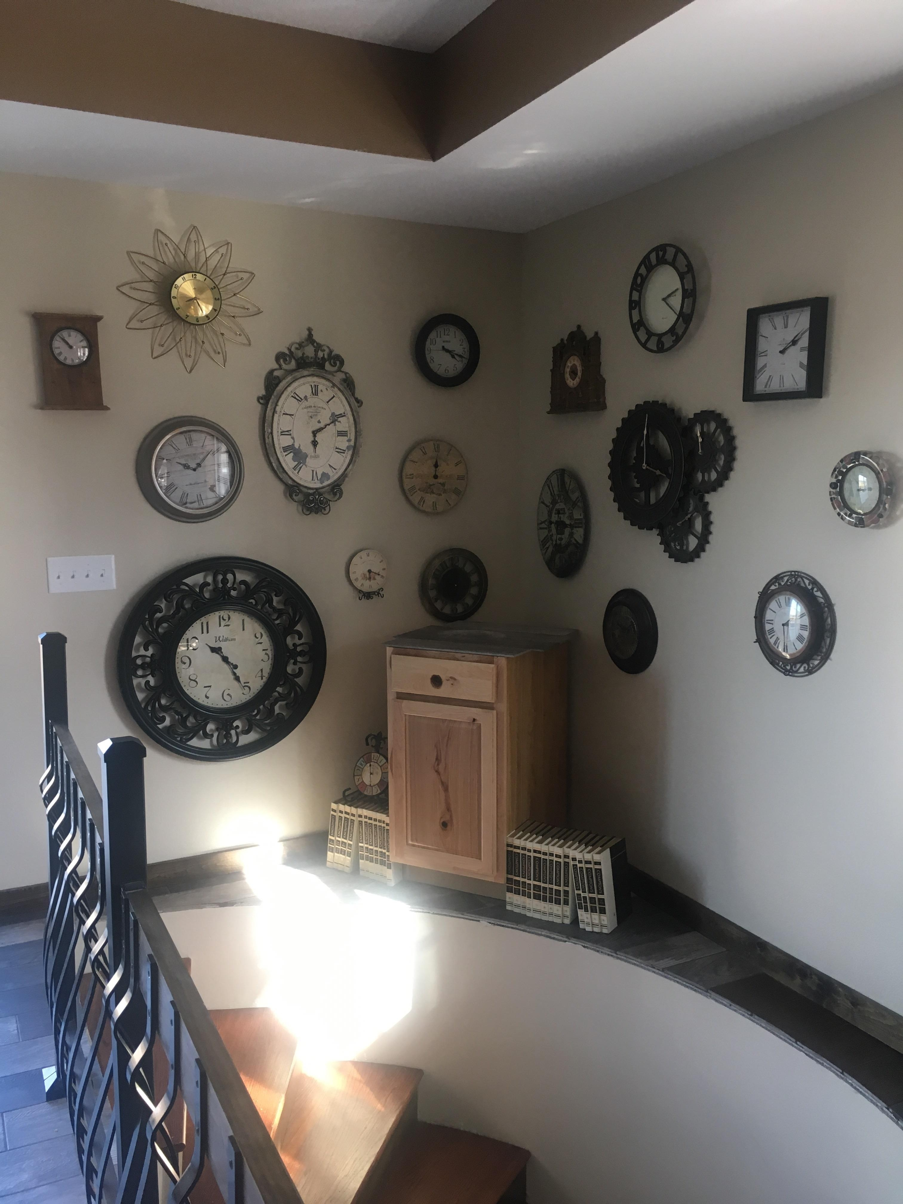 This Clock Wall Is Over A Spiral Staircase With A Half Moon | 12 Foot Spiral Staircase | Lowes | Stair Treads | Black Spiral | Steel | Gray Interior