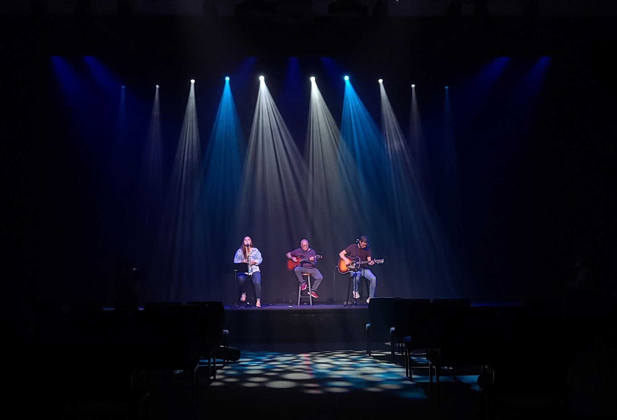between stage and lighting arrangements