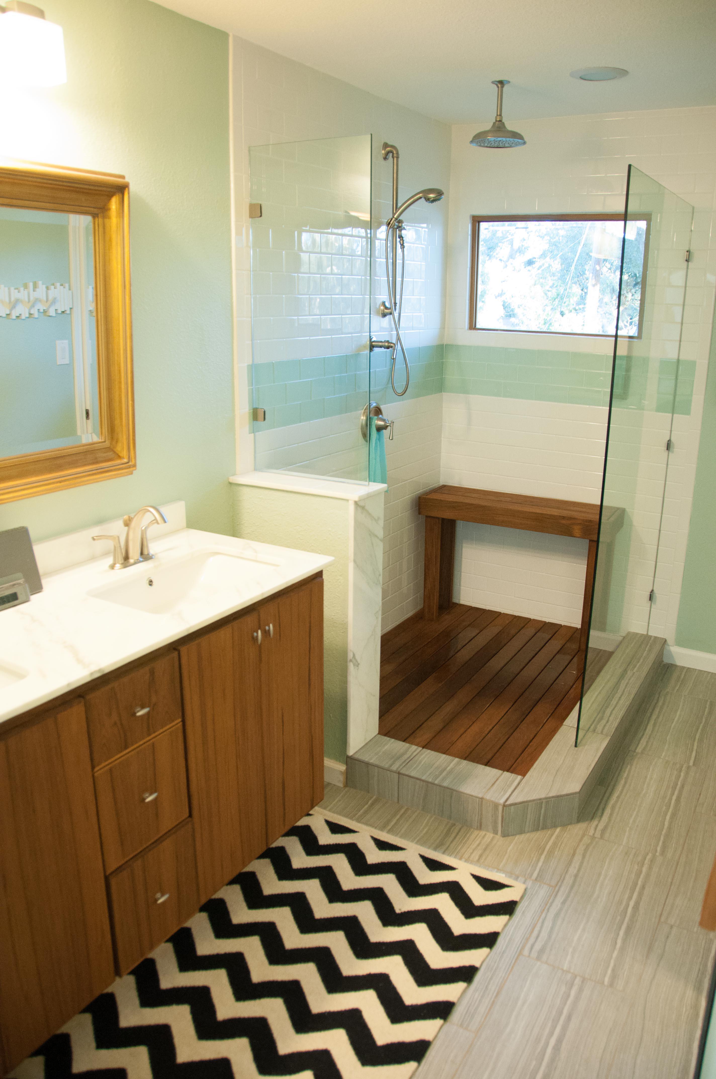 tile floor and the teak shower floor