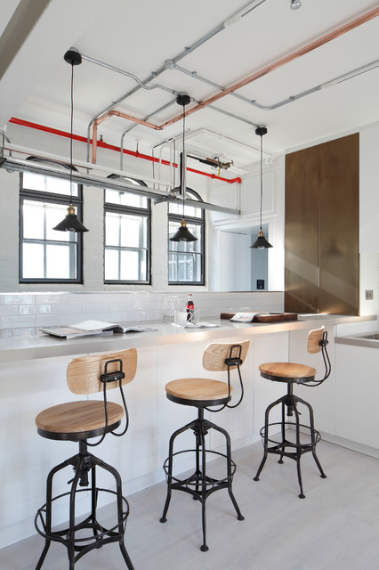 gorgeous modern kitchen with bare pipe communications