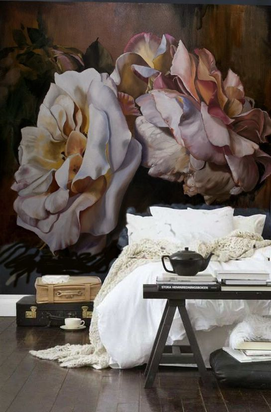 gorgeous oversized floral wallpaper wall is a focal point in this space