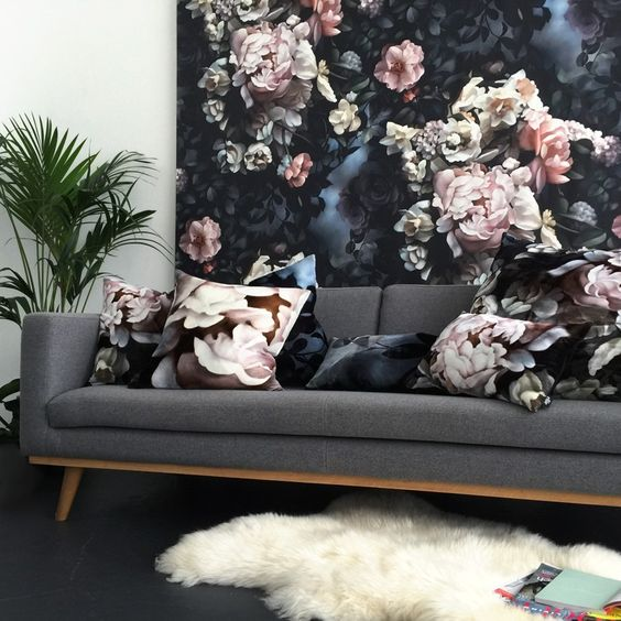 a moody floral wall and matching pillows to tie the look up