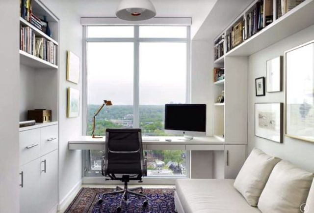 small minimalist home office in white with a glazed wall and a view on the town