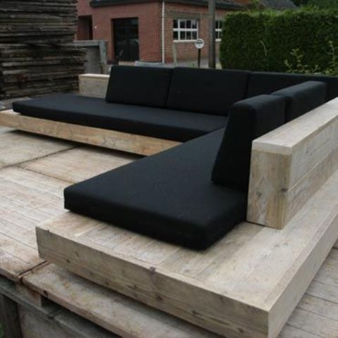 timber seating wih black cushions is an elegant combo