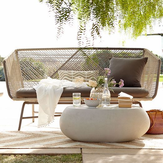 an ethereal wicker seating on metal legs looks very stylish and boho chic