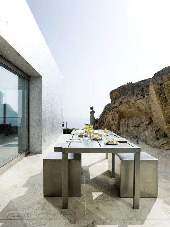 concrete and stainless steel are among the best solutions for outdoor furniture because of low maintenance and durability