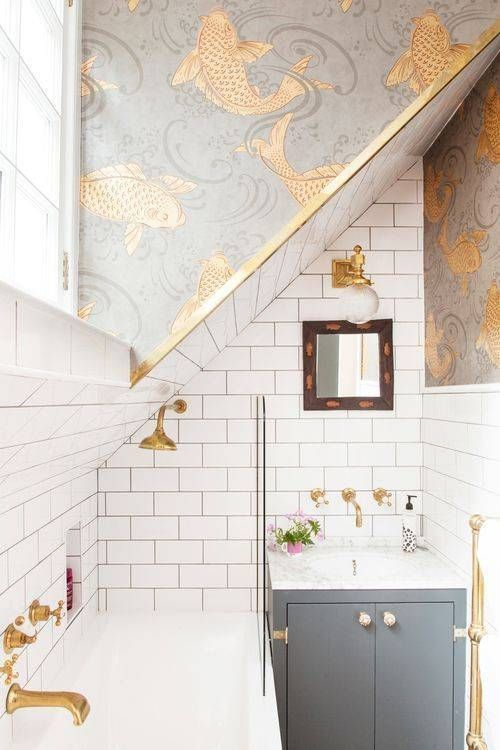 15 Catchy Bathroom Wallpaper Ideas   Shelterness a grey and white bathroom with gold detailing and grey and gold fish print  wallpaper