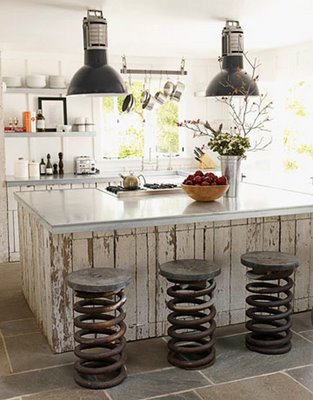 Industrial Country Decor Rustic Kitchen with Weathered Wood Island and Industrial Metal Coil Stools