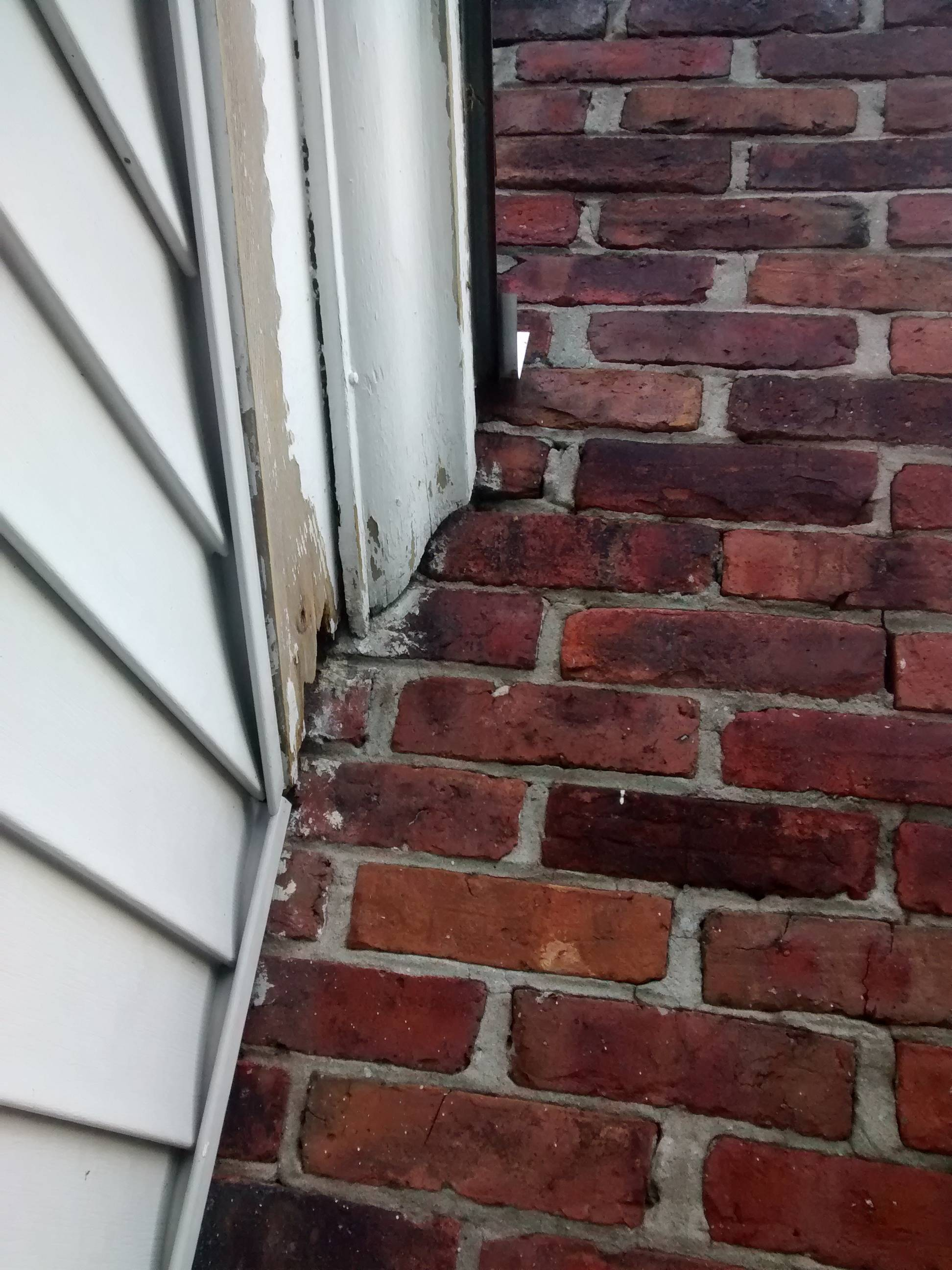 How Should I Protect Wooden Trim That Abuts A Brick