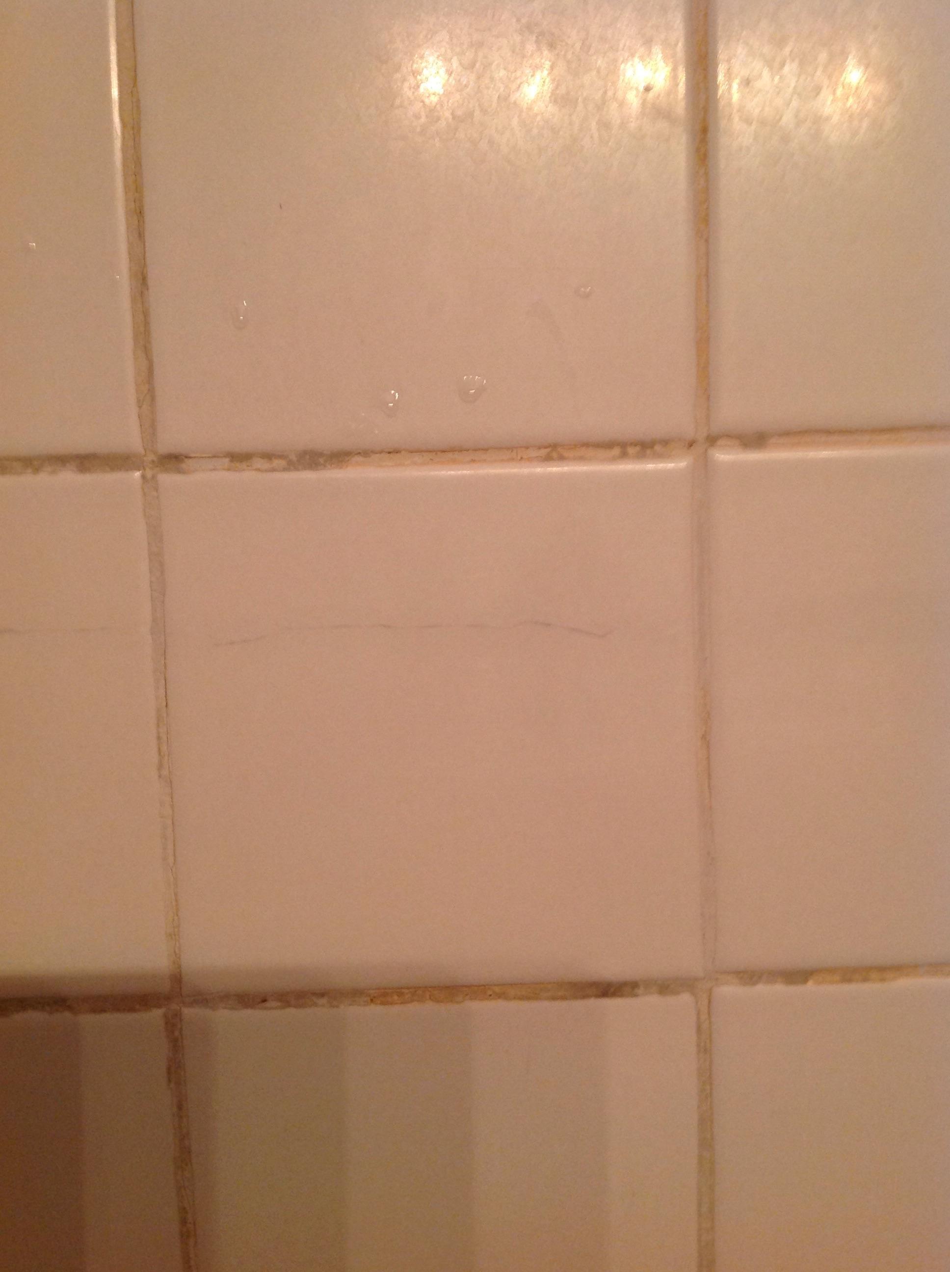 cracked bathroom tile runs almost
