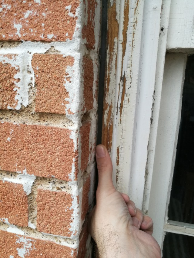 How to fill this gap between window and brick wall? (too deep for