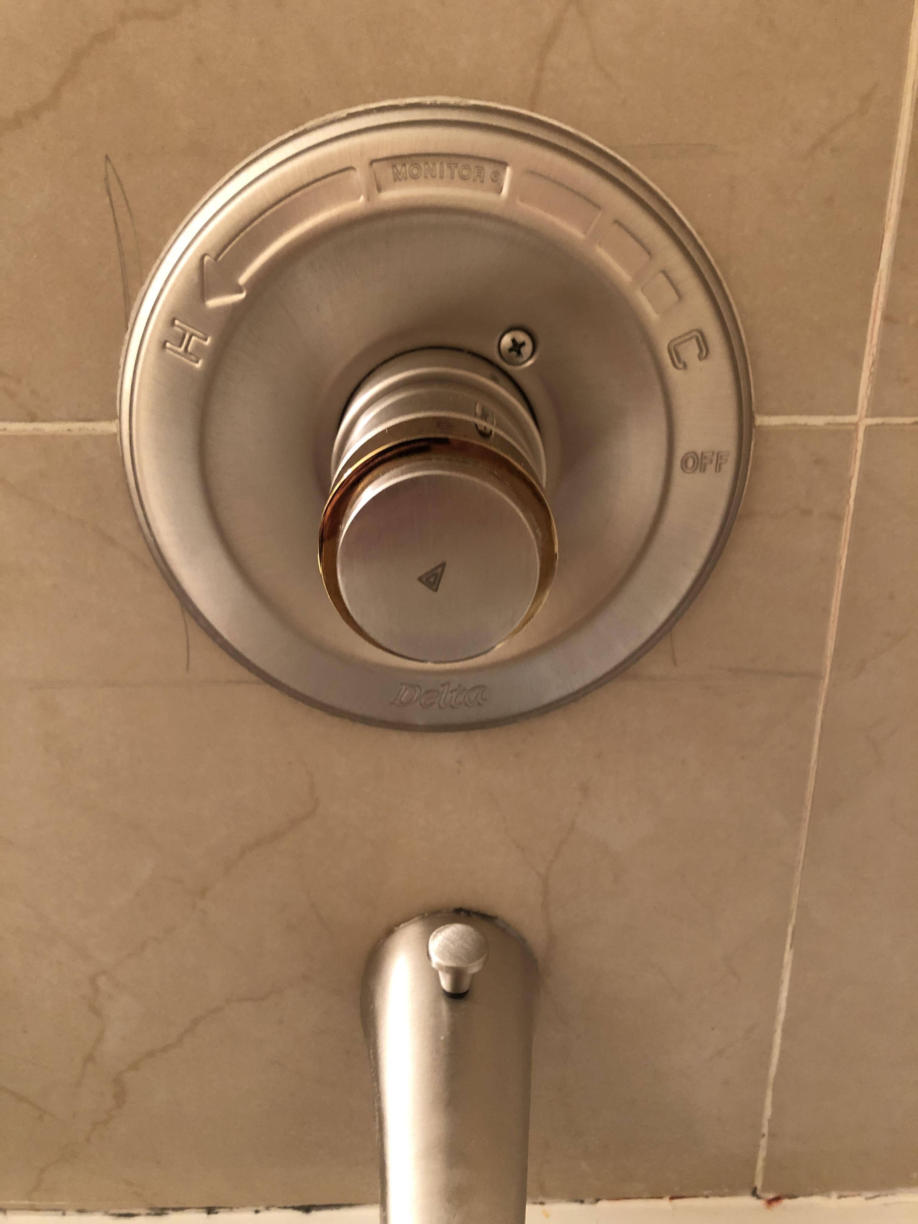 remove caps on circular faucet handles