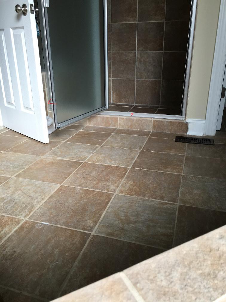 fix squishy tiles in shower floor