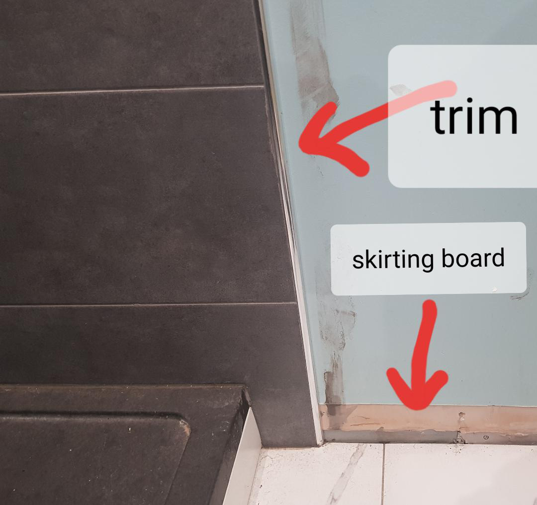 join baseboard to tile trim on wall