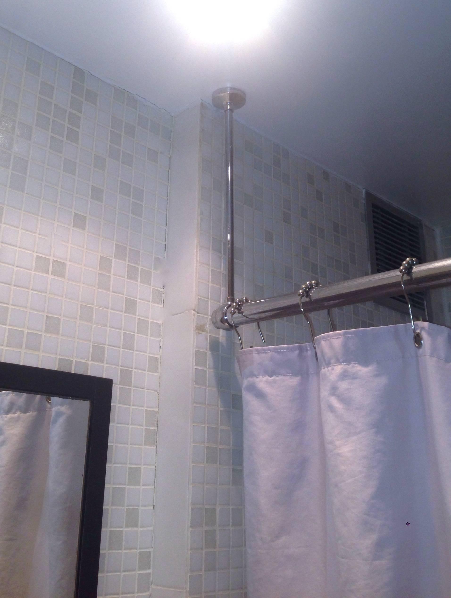 rehang a shower curtain rod