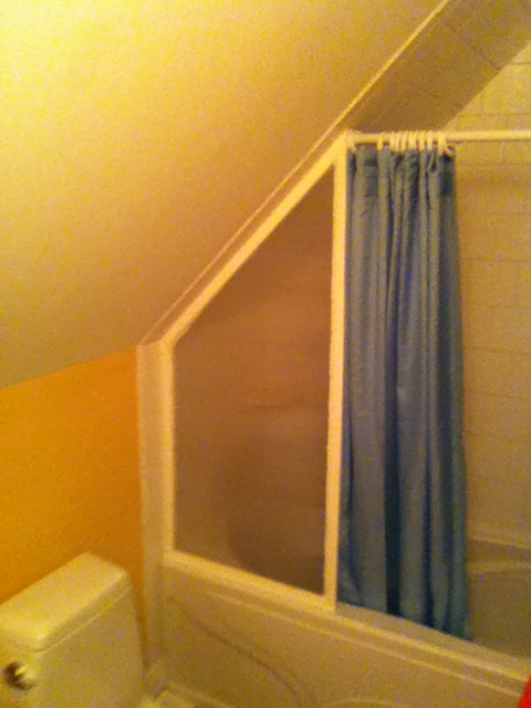 install a glass shower screen against