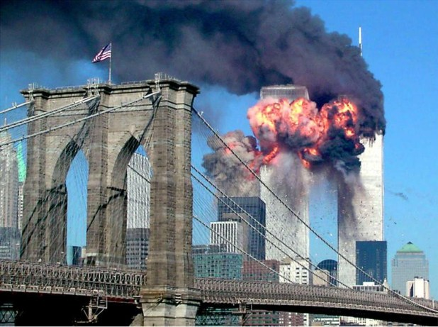 The second tower of the World Trade Center bursts into flames after being hit by a hijacked airplane, September 11, 2001. [Photo: Reuters]