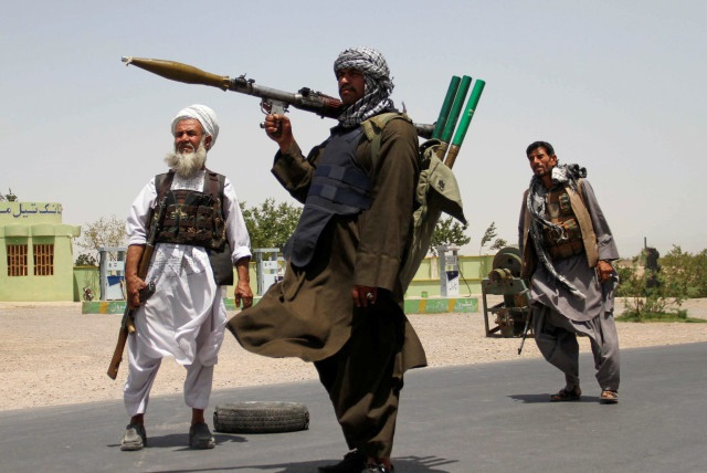Former Mujahideen hold weapons to support Afghan forces in their fight against Taliban, on the outskirts of Herat province, Afghanistan July 10, 2021. PHOTO: REUTERS