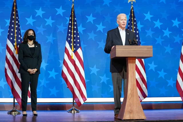 Democratic US presidential nominee Joe Biden is accompanied by vice presidential nominee Kamala Harris as he makes a statement on the 2020 U.S. presidential election results during a brief appearance before reporters in Wilmington, Delaware, US, November 5, 2020. PHOTO: REUTERS