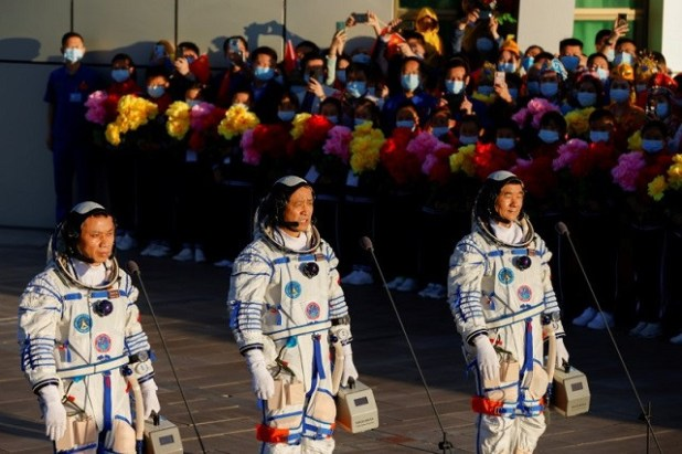 Chinese astronauts Tang Hongbo, Nie Haisheng and Liu Boming speak before the launch of the Long March-2F Y12 rocket, carrying the Shenzhou-12 spacecraft and the three astronauts, from Jiuquan Satellite Launch Center for China's first manned mission to build its space station, near Jiuquan, Gansu province, China June 17, 2021. PHOTO: REUTERS