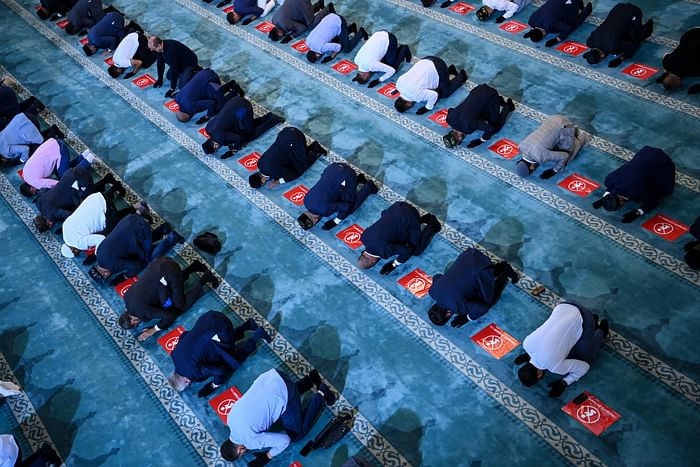 Russian Muslims gather in the Sobornaya mosque, Moscow Cathedral Mosque on July 20, 2021 during celebrations of Eidul Azha. PHOTO: AFP