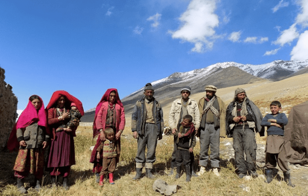 This photograph taken on October 8, 2017 shows Afghan Wakhi nomad family posing for a picture in the Wakhan Corridor in Afghanistan. The region is so remote that its residents, known as the Wakhi - a tribe of roughly 12,000 nomadic people who populate the area - are untouched by decades of conflict devastating their country. [Photo: AFP]