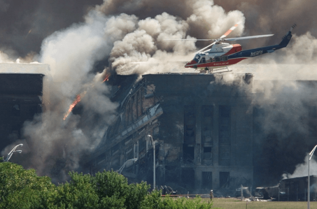 A medical rescue helicopter hovered above the Pentagon as firefighters battled flames after Flight 77 crashed into the US military headquarters on September 11, 2001 [Photo: Reuters]