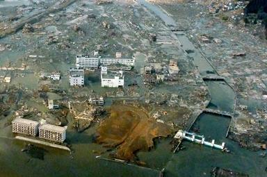 The town Minamisanriku is still submerged Saturday after Friday's strong earthquake-triggered tsunami in Miyagi prefecture, northern Japan.