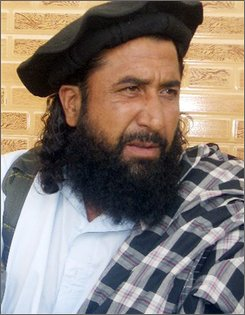 Maulvi Umar, a Taliban spokesman, speaks during a press conference in Khar, the main town of Pakistan tribal region Bajur, Tuesday, Aug. 5, 2008. Umar is warning Pakistan's government to end a military crackdown against insurgents or face suicide bombings and other attacks. (AP Photo/Anwarullah Khan)