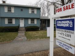 This April 12, 2011 photo shows a home for sale in North Andover, Mass.