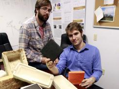 Gavin McIntyre, left, and Eben Bayer, co-founders of Ecovative Design, with some of their eco-friendly packaging materials.