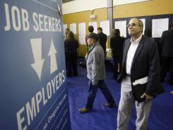 Job seeker Alan Shull looks on during a job fair April 24 in Portland, Ore.