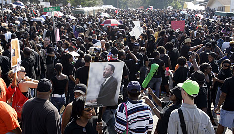 Thousands of chanting demonstrators filled the streets of this little Louisiana town Thursday. It's not about black and white. It's about right and wrong. I would like to see these young men set free,