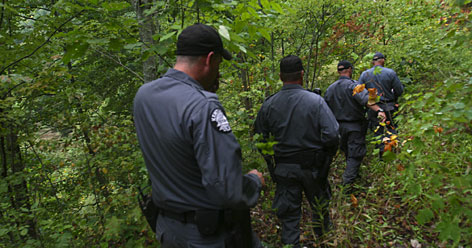 """Kentucky state police, National Guard members, Drug Enforcement Administration agents, U.S. Forest Service spotters and others are part of a strike force based in London, Ky., that works dawn to dark to eradicate marijuana harvests. The remote and rugged terrain, including the 700,000 acres of the Daniel Boone National Forest, is a pot-grower's paradise whose perfect soil and climate give it a key place in America's """"Marijuana Belt."""""""