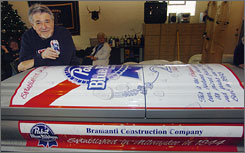 Bill Bramanti poses with a coffin he had specially made designed to look like a can of his favorite beer. For now, he's using it as a cooler.