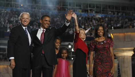 The Bidens and Obamas receive the crowds cheers Thursday at the end of the Democratic National Convention. (USA Today)