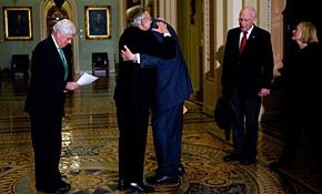 Senate Majority Leader Harry Reid, D-N.V., hugs Sen. Jay Rockefeller, D-W.V., following the Senate's cloture vote on health care reform legislation on Capitol Hill on Nov. 21. The Senate approved the motion to bring the bill to a full debate on the floor of the Senate by 60-39 vote.
