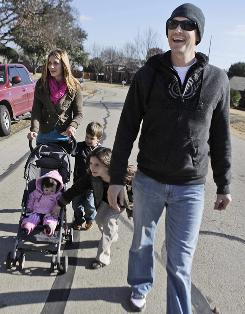 In this January photo, pastor Matt Chandler leads his family on a walk in Flower Mound, Texas, after a treatment session for brain cancer.