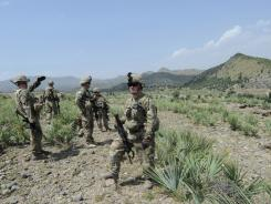 U.S. Army Capt. Aaron Tapalman takes part in a foot patrol Friday with his troops in a mountainous area near the border with Pakistan at Combat Outpost Sabari in Khost province.