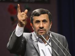 Iranian President Mahmoud Ahmadinejad, gestures, as he delivers a speech Wednesday.