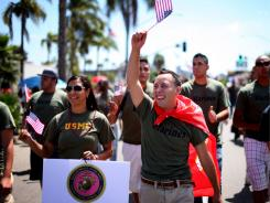 Marine Jaime Rincon, center, marches down University Avenue with other military personel during a gay pride parade July 16 in San Diego, Calif.