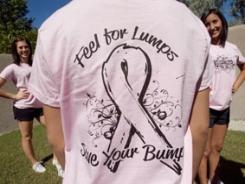 """Feel for lumps, save your bumps"" T-shirts were purchased for Gilbert High School cheerleaders in Arizona to wear during a fundraiser for breast-cancer research. The school's principal says the message is inappropriate and has banned the shirts."