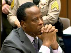 Conrad Murray listens Tuesday as Judge Michael Pastor sentences him to the maximum four years in county jail for his involuntary manslaughter conviction in the death of pop star Michael Jackson.