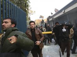 Iranian protesters enter the British embassy in Tehran on Tuesday, which led to the expulsion of Iranian diplomats from the U.K.