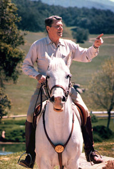 Always at home on the range, President Reagan rides at his California ranch, Rancho del Cielo. He spent 335 days of his eight-year presidency there relaxing.