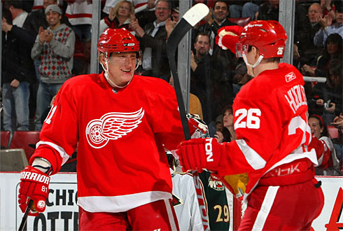 The Red Wings Jiri Hudler, right celebrates his goal against the Minnesota Wild with teammate Marian Hossa during their NHL game in Detroit. By Dave Sandford, Getty Images