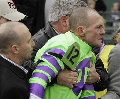 Jockey Calvin Borel is restrained after the Breeders' Cup Marathon race at Churchill Downs.